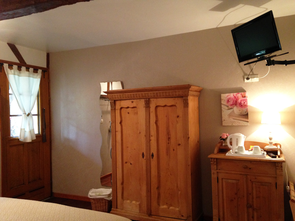 Double bed hotel room with TV, wardrobe,...